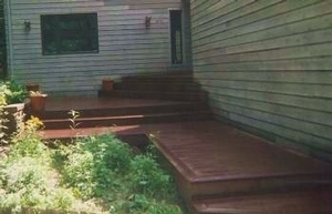 This is larger entry deck we built out of composite decking with several sets of steps leading to their entry door.
