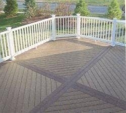 A larger 2 color composite deck with white railing. We broke the decking off into sections for a more unique look.