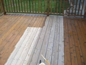 This is a close up of a deck in the process of being stained/sealed.