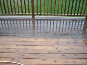 At PSA we offer power washing of decks and then staining/sealing the deck for a fresh look. This is a close up of a deck in the process of being power washed. See the difference?