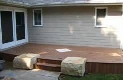 In this deck, we ran the composite decking boards at angles and built large pieces of limestone into the deck as an accent to the steps.