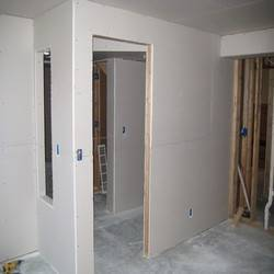 A look from inside the bedroom/office after most of the drywall was installed.