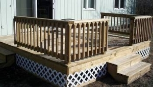 Wood deck we installed with a wood railing system and spindles.